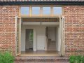 Replacement oak bi-fold doors shown fully open