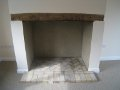 Original fireplace with Bressumer and new hearth, using re-claimed bricks